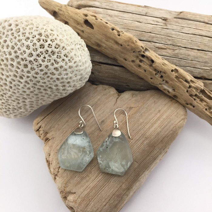 AQUA EARRINGSNatural stone, aquamarine, and silver earrings. Unique and original pieces that highlight the natural beauty of the