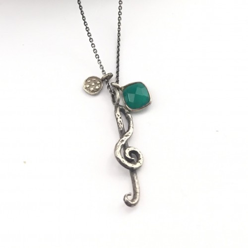 Silver chain with musical treble clef pendant and natural stone.