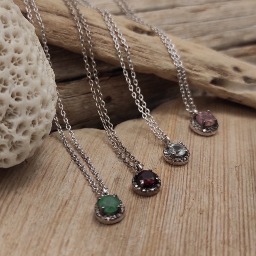 Silver chain with a natural stone pendant surrounded by diamonds. Timeless and romantic style pendant. The perfect present!